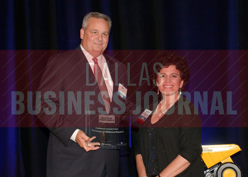 ken Reese, left, accepts the Commercial Property of the Year award for The Towers at Williams Square from Allison Thompson of Best Real Estate Deals presenting sponsor The City of Cedar Hill.