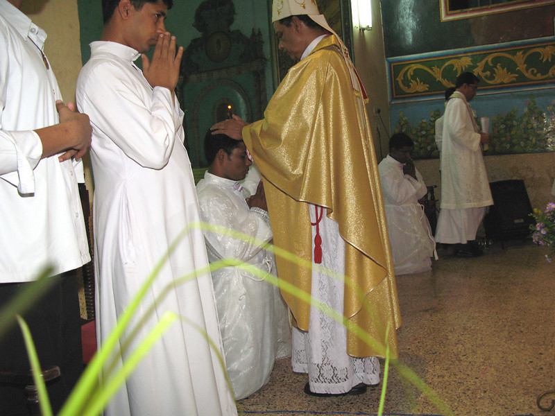 The bishop ordains Jijo, laying his hands on his head, in silence.