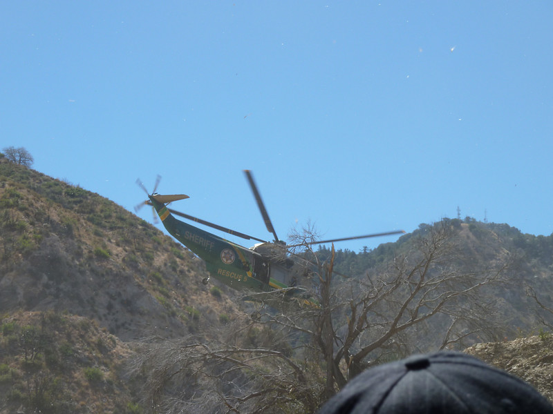 Los Angeles Rescue 5 helicopter, flying away from motorcycle crash.