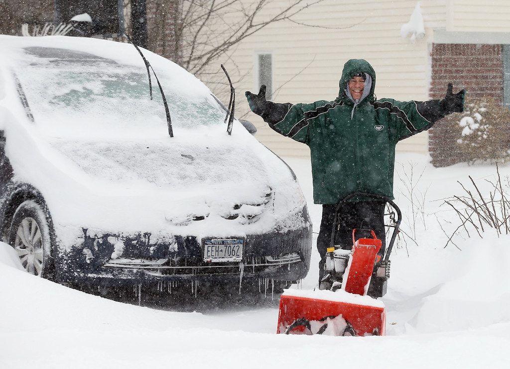 . Homeowner Jonathan Spatz takes a break while clearing a neighbors driveway on January 27, 2015 in Old Bethpage. New York. Much of the Northeast was hit with heavy overnight snow from Winter Storm Juno.  (Photo by Bruce Bennett/Getty Images)
