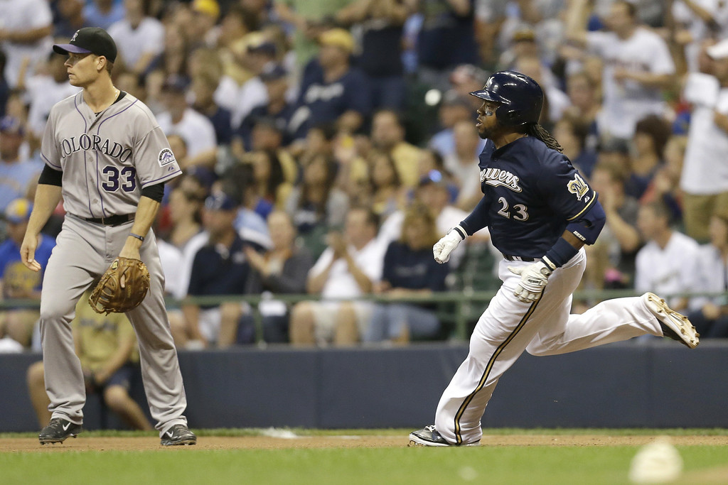 . MILWAUKEE, WI - JUNE 27: Rickie Weeks #23 of the Milwaukee Brewers runs the bases after hitting a double in the bottom of the sixth inning against the Colorado Rockies at Miller Park on June 27, 2014 in Milwaukee, Wisconsin. (Photo by Mike McGinnis/Getty Images)