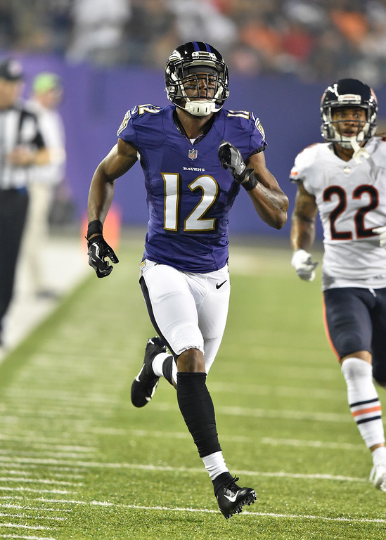 . Baltimore Ravens wide receiver Jaleel Scott (12) runs on a punt against the Chicago Bears in the first half at the Pro Football Hall of Fame NFL preseason game, Thursday, Aug. 2, 2018, in Canton, Ohio. (AP Photo/David Richard)