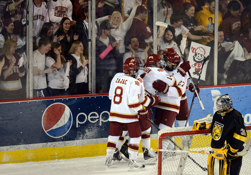 . DENVER, CO. - FEBRUARY 08: Lakin Jacobson of University of Denver #14 and his teammates celebrate his goal in the 1st period of the game February 8, 2013 at Magness Arena in Denver, Colorado. (Photo By Hyoung Chang/The Denver Post)