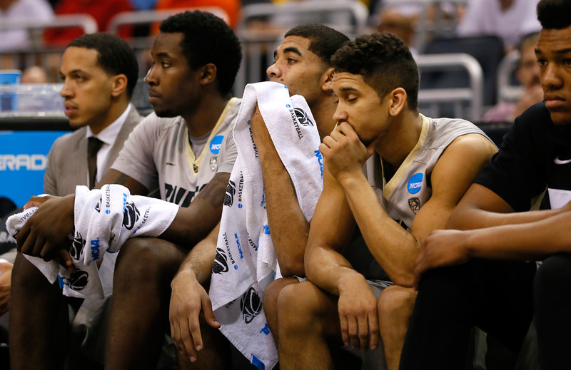 . (R-L) Askia Booker #0, Xavier Talton #3 and Wesley Gordon #1 of the Colorado Buffaloes on the bench in the first half while taking on the Pittsburgh Panthers during the second round of the 2014 NCAA Men\'s Basketball Tournament at Amway Center on March 20, 2014 in Orlando, Florida.  (Photo by Kevin C. Cox/Getty Images)