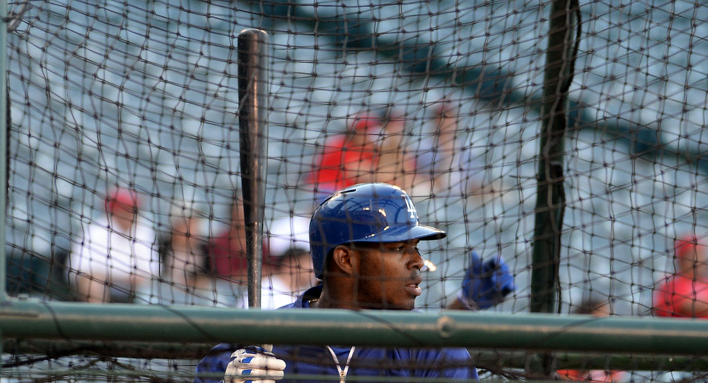 . Los Angeles Dodgers\' Yasiel Puig takes batting practice prior to a baseball game against the Los Angeles Angels at Anaheim Stadium in Anaheim, Calif., on Thursday, Aug. 7, 2014.  (Photo by Keith Birmingham/ Pasadena Star-News)