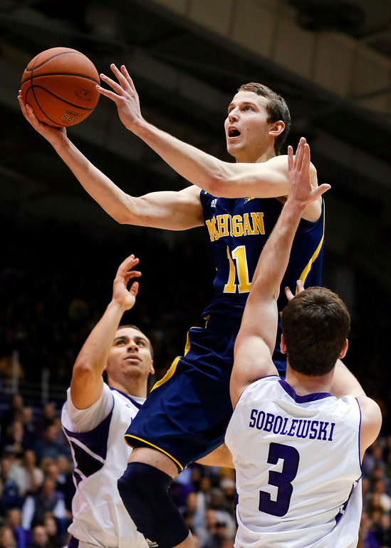 . Nik Stauskas Deemed one of the top shooters in the draft, the Michigan guard played alongside Trey Burke and Tim Hardaway Jr. his freshman year, serving primarily as a spot-up shooter. But in his second year, he showed he could do much more, on both ends of the floor and is now one of the draft�s more intriguing prospects.  Michigan guard Nik Stauskas (11) drives to the basket between Northwestern guard Tre Demps, left, and guard Dave Sobolewski during the first half of an NCAA college basketball game in Evanston, Ill., Thursday, Jan. 3, 2013. (AP Photo/Nam Y. Huh)