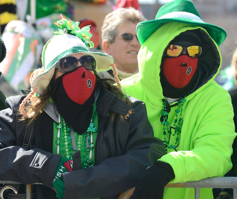 . Maribeth Joeright/MJoeright@News-Herald.com<p> Holly and Joe Novak of Fairport Harbor pull out all the stops to stay warm as they watch the 147th annual St. Patrick\'s Day parade in Cleveland, March 17 2014.