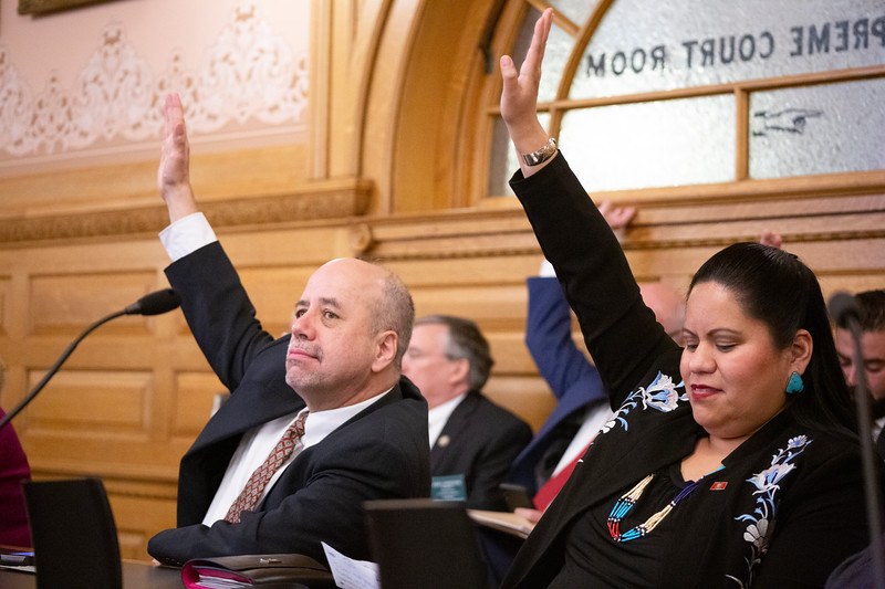 Rep. Tom Sawyer (left) and Rep. Ponka-We Victors raise their hands for a motion during Democratic leadership elections