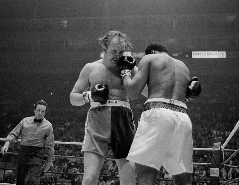 . Heavyweight champion Muhammad Ali lands left to chin of challenger Chuck Wepner in first round of their title bout at the Cleveland Coliseum in Richfield, Ohio on Monday, March 24, 1975. (AP Photo/Harry Cabluck)