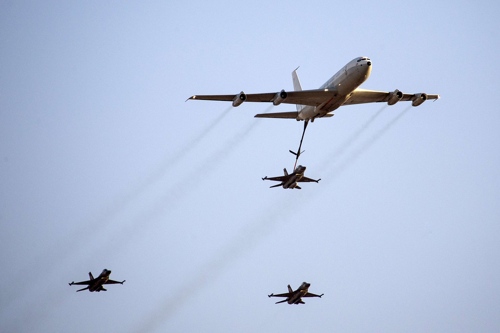 . An Israeli F-16 fighter jet is refueled by a Boeing 707 during an air show at the graduation ceremony of Israeli pilots in the Hatzerim air force base in the southern Negev desert, near the southern Israeli city of Beersheva on December 26, 2013. AFP PHOTO/JACK GUEZ/AFP/Getty Images