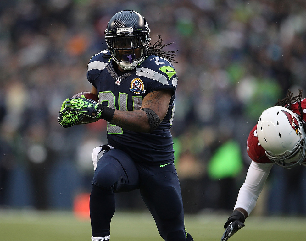 . Marshawn Lynch #24 of the Seattle Seahawks runs the ball for a 15-yard gain against the Arizona Cardinals at CenturyLink Field on December 9, 2012 in Seattle, Washington.  (Photo by Kevin Casey/Getty Images)