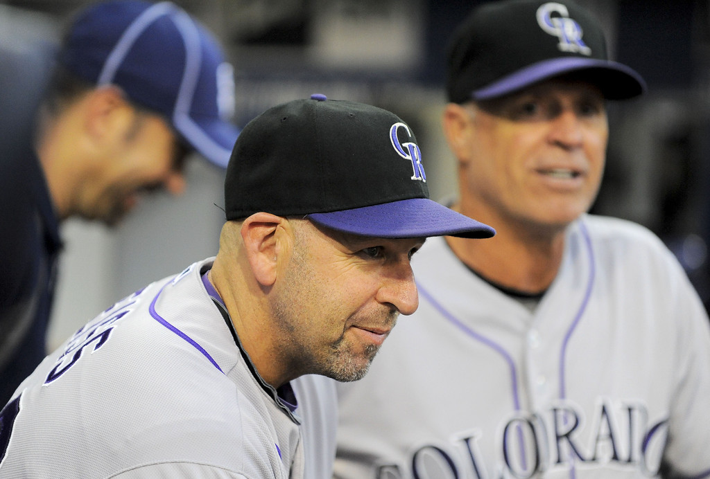 . SAN DIEGO, CA - SEPTEMBER 6:  Walt Weiss #22 of the Colorado Rockies (C) looks on from the dugout before a baseball game against the San Diego Padres at Petco Park on September 6, 2013 in San Diego, California.  (Photo by Denis Poroy/Getty Images)