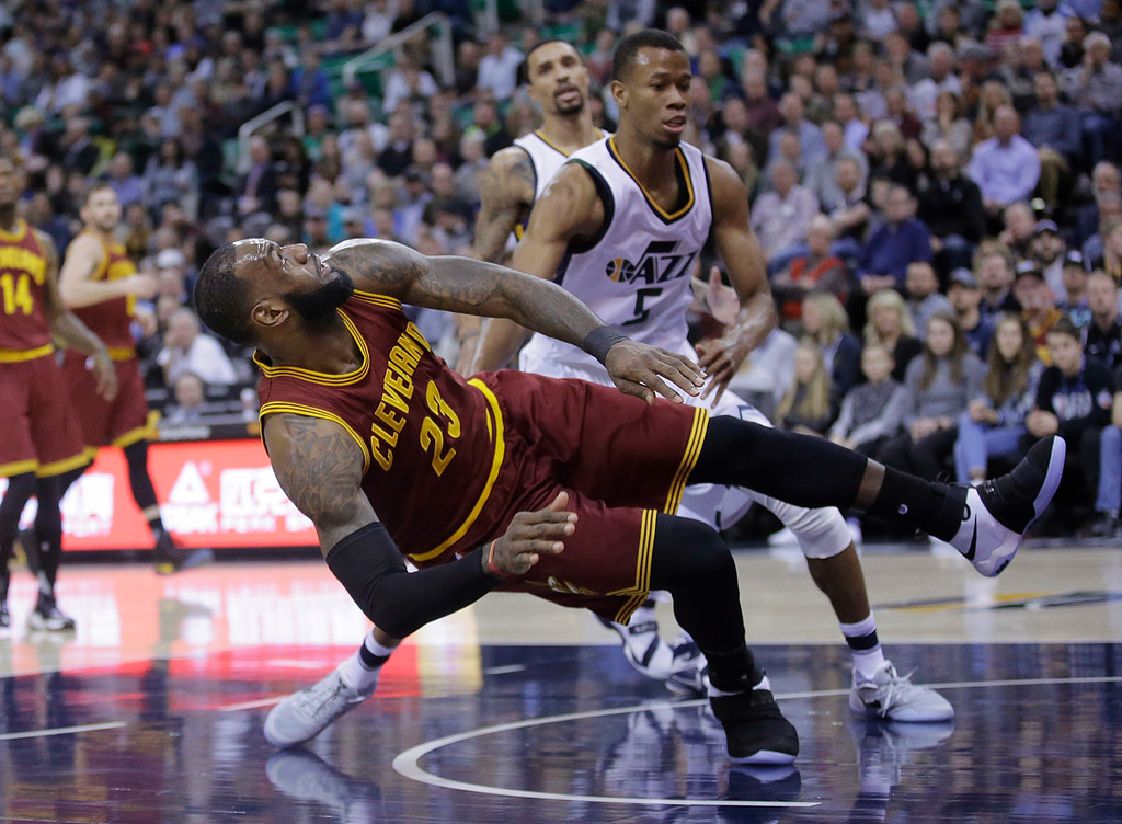. Utah Jazz guard Rodney Hood, rear, fouls Cleveland Cavaliers forward LeBron James (23) as he shoots in the first half during an NBA basketball game Tuesday, Jan. 10, 2017, in Salt Lake City. (AP Photo/Rick Bowmer)