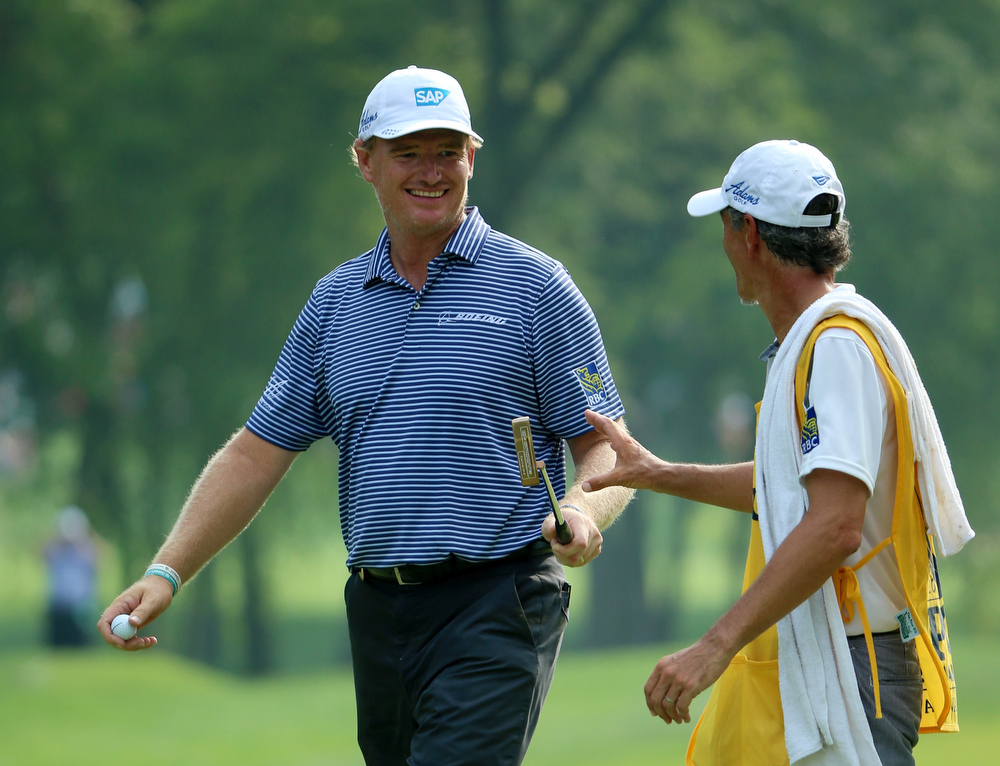 . Ernie Els of South Africa reacts on the 15th green alongside caddie Colin Byrne during the final round of the 96th PGA Championship at Valhalla Golf Club on August 10, 2014 in Louisville, Kentucky.  (Photo by Andrew Redington/Getty Images)