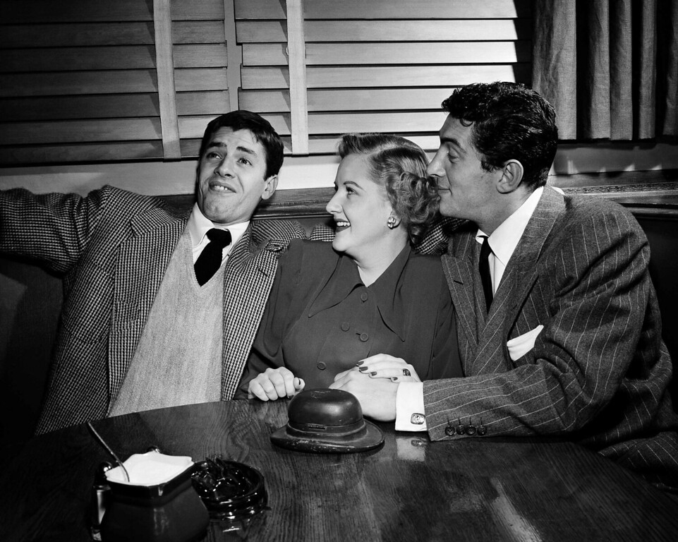 """. Jerry Lewis (left) whips through his portion of the famous Lewis-Martin comic routine, while Margaret  Whiting and Dean Martin look on at the Hollywood Brown Derby on Jan. 21, 1949 in Los Angeles.    Martin and Lewis soon will make their film debut in \""""My Friend Irma.\""""    (AP Photo)"""