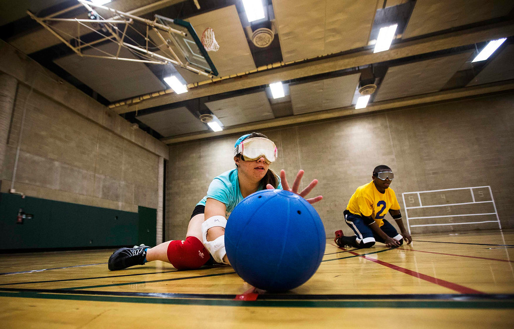 . Meghan Fink (L) and Wayne Eberson take part in goal ball at Camp Abilities in Brockport, New York, June 25, 2013. Camp Abilities is a not-for-profit week-long developmental camp using sports to foster greater independence and confidence in children who are blind, visually impaired, and deaf-blind. Photo taken June 25, 2013.      REUTERS/Mark Blinch