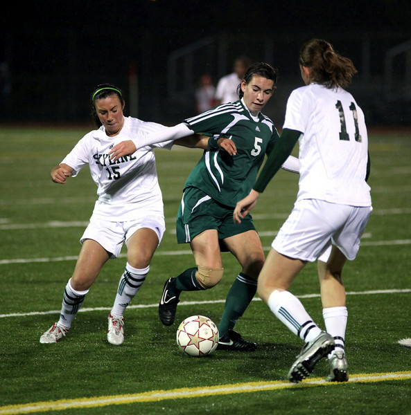 Woodinville:  Maggie Stinson;  Skyline: Nicole Candioglos, Michelle Breti Woodinville High Girls Varsity Soccer 2010  ©Neir