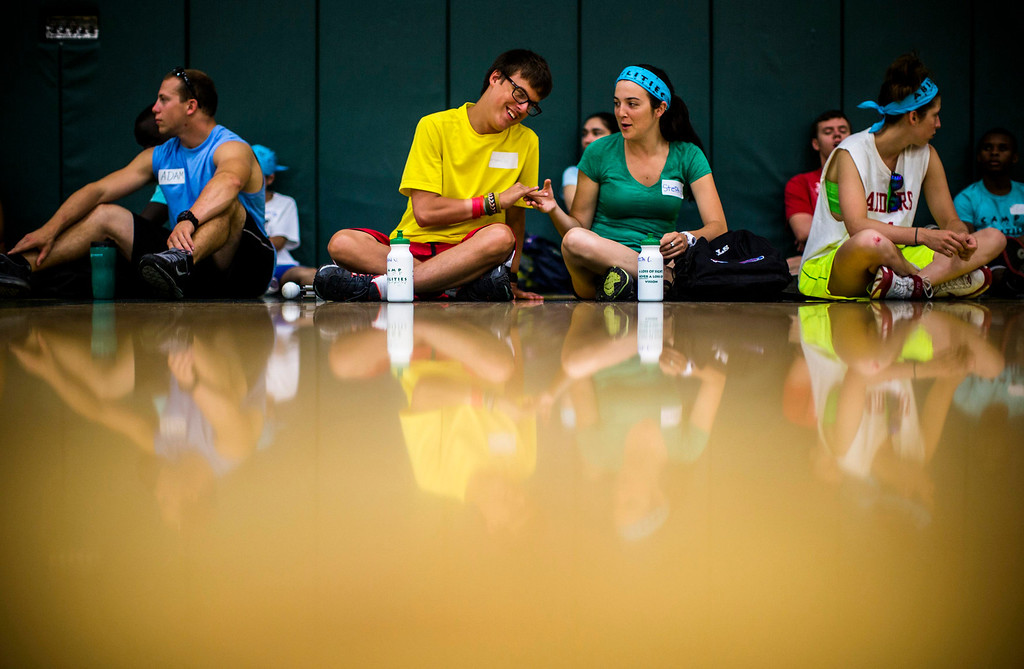 . Jordan Vieira (2nd L) sits with counselor Stephanie Connolly (2nd R) at Camp Abilities in Brockport, New York, June 26, 2013.  Camp Abilities is a not-for-profit week-long developmental camp using sports to foster greater independence and confidence in children who are blind, visually impaired, and deaf-blind. Photo taken June 26, 2013.     REUTERS/Mark Blinch