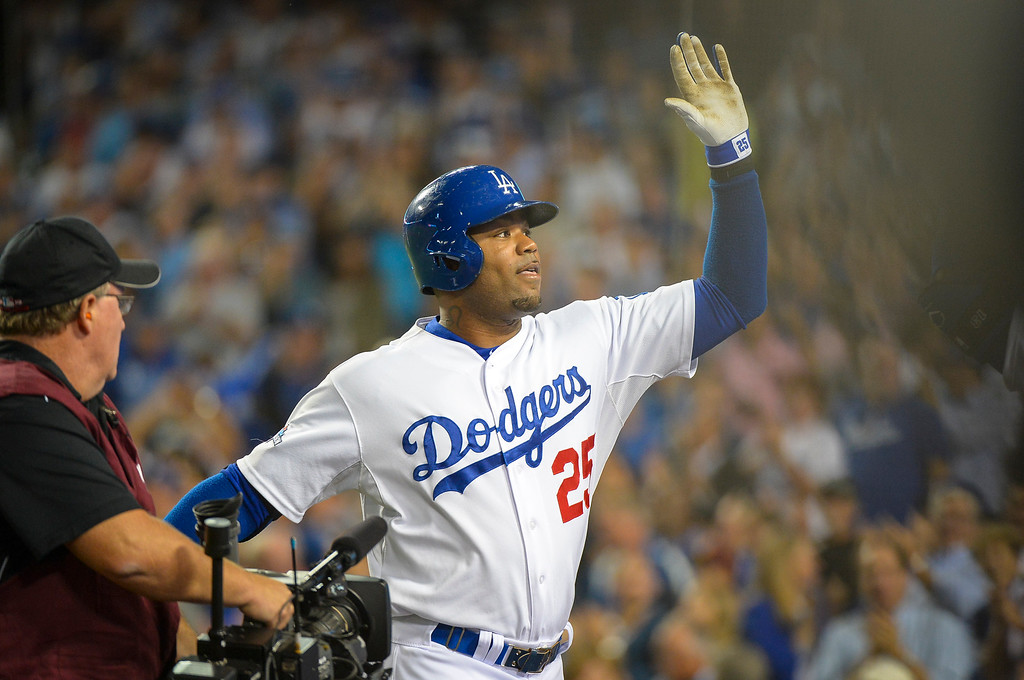 . Dodgers Carl Crawford greets the team after hitting a solo HR during his first at bat against Atlanta\'s Freddy Garcia during game action Monday, October 7, 2013 ( Photo by Andy Holzman/Los Angeles Daily News )