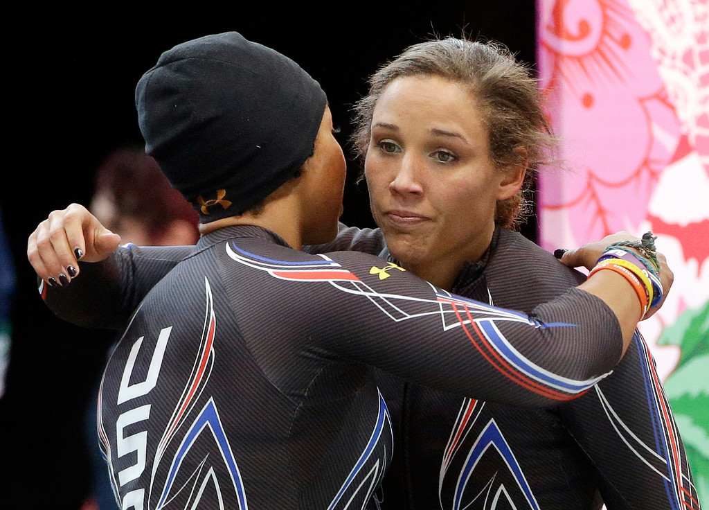 . The team from the United States USA-3, pilot Jazmine Fenlator, left, and brakeman Lolo Jones, hug after their second run during the women\'s two-man bobsled competition at the 2014 Winter Olympics, Tuesday, Feb. 18, 2014, in Krasnaya Polyana, Russia. (AP Photo/Dita Alangkara)
