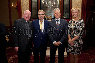 First Minister Peter Robinson is pictured at the Chamber Gala Dinner with Bishop John McAreavey, Gerald O'Hare and Deborah Loughran. R1427116