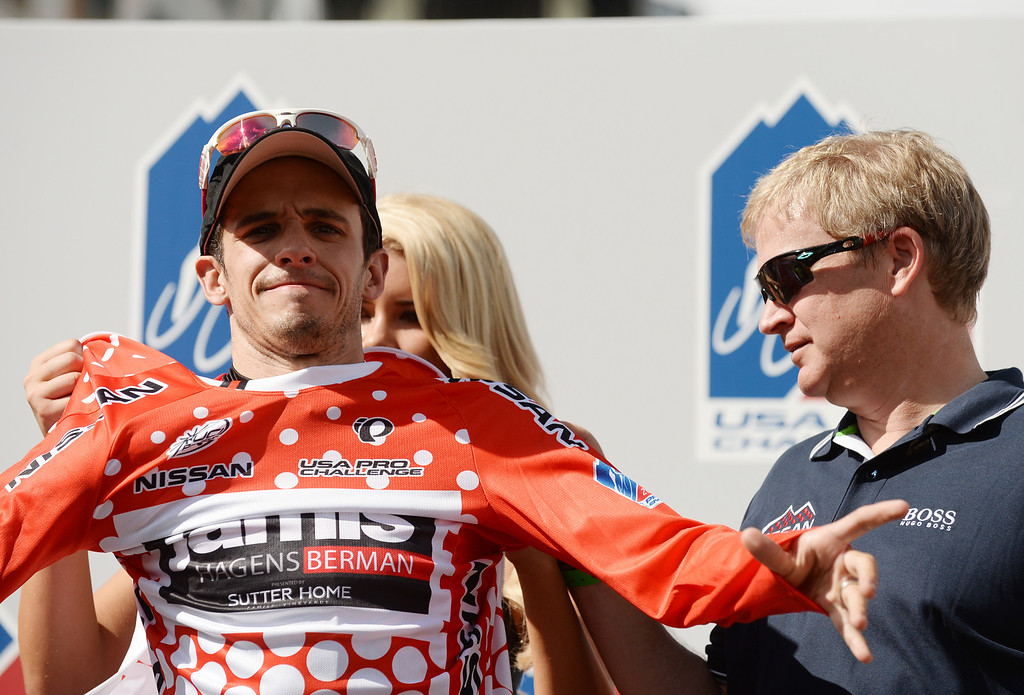 . Matt Cooke of Jamis-Hagens puts the King of Mountain Jersey on after finishing the 75-mile 7th stage of 2013 USA Pro Challenge race in Denver, Colorado on August 25, 2013. (Photo by Hyoung Chang/The Denver Post)