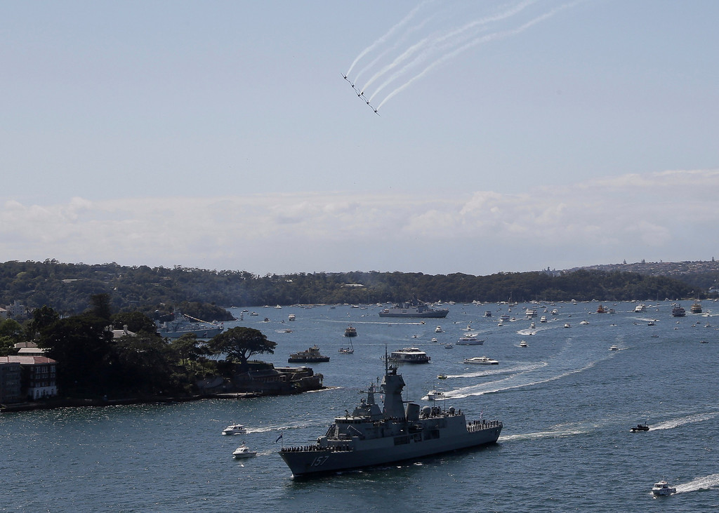 . Royal Australian Air Force Roulettes fly towards HMAS Perth as she sails in Sydney Harbour in Australia, Friday, Oct. 4, 2013 during the International Fleet review. The Fleet Review is a commemorative event celebrating the centenary of the first entry of the Royal Australian Navy\'s fleet into Sydney Harbour on Oct. 4, 1913.(AP Photo/Rob Griffith)