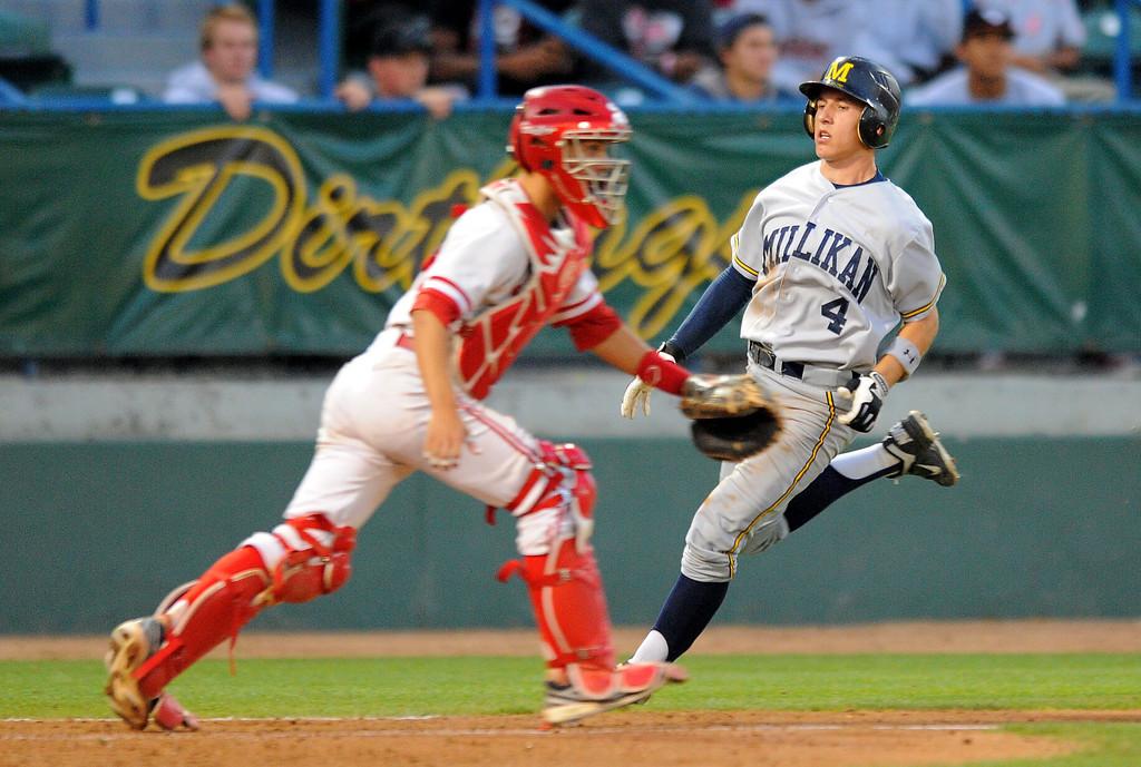 . LONG BEACH - 05/01/13 - (Photo: Scott Varley, Los Angeles Newspaper Group)  Lakewood vs Millikan baseball at Blair Field. Millikan\'s Johnny Weeks scores in the 5th as Kyler Kolb waits for the ball.