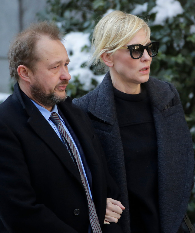 . Filmmaker Andrew Upton, left, and his wife Cate Blanchett arrive for the funeral of actor Philip Seymour Hoffman at the Church of St. Ignatius Loyola, Friday, Feb. 7, 2014 in New York. Hoffman, 46, was found dead Sunday of an apparent heroin overdose. (AP Photo/Mark Lennihan)