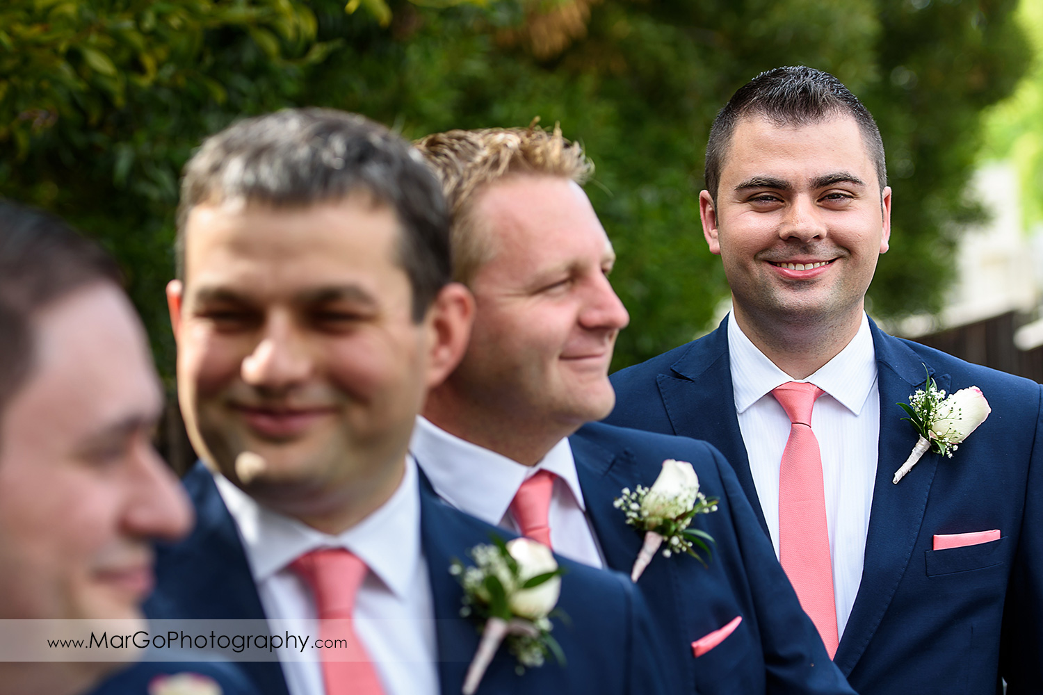 close-up portrait of groom and groomsmen in blue suit and pink tie at Saratoga Foothill Club