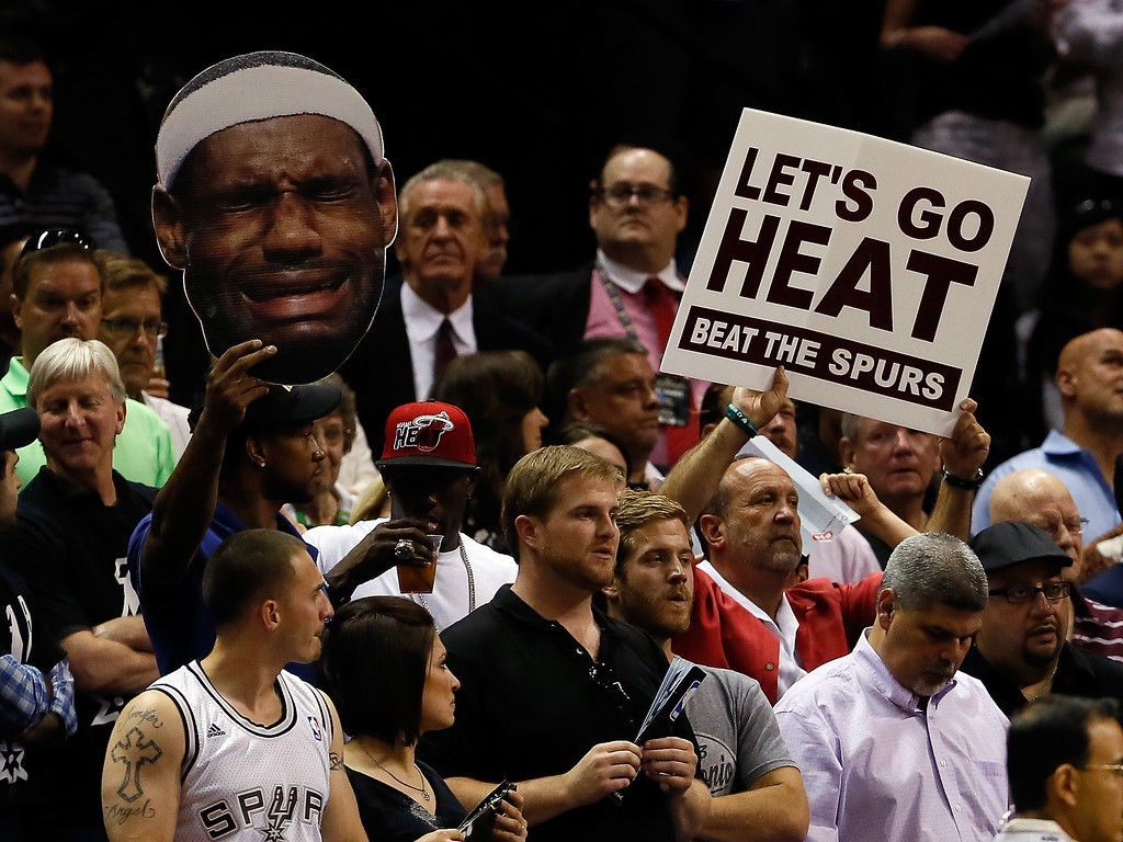 . Fans hold up a cut-out of LeBron James #6 of the Miami Heat and a sign in the fourth quarter during Game Five of the 2013 NBA Finals at the AT&T Center on June 16, 2013 in San Antonio, Texas.  (Photo by Kevin C. Cox/Getty Images)