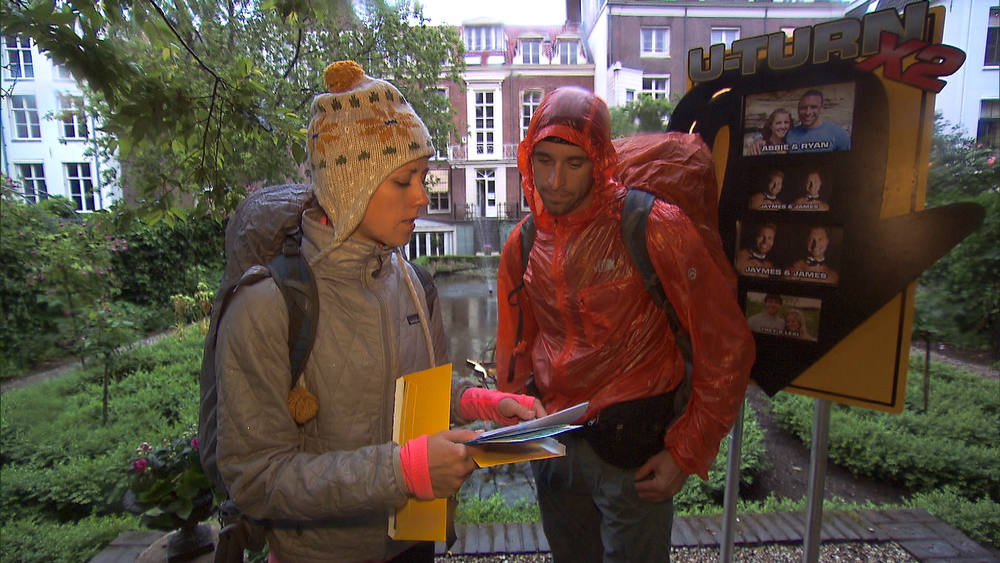 ". ""Fishy Kiss (Amsterdam, Netherlands))\""--After making their way to the Museum Geelvinck Gardens, Dating Divorcees Abbie (left) and Ryan (right) find that they have been U-Turned by another team on THE AMAZING RACE on the CBS Television Network. Photo: CBS ©2012 CBS Broadcasting, Inc. All Rights Reserved"