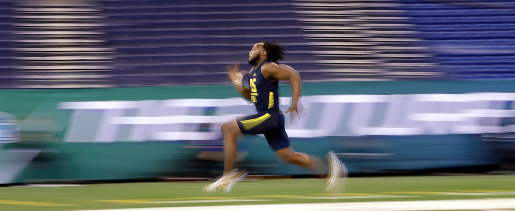 . In this image taken with a slow shutter speed, UTEP running back Aaron Jones runs the 40-yard dash at the NFL football scouting combine Friday, March 3, 2017, in Indianapolis. (AP Photo/David J. Phillip)