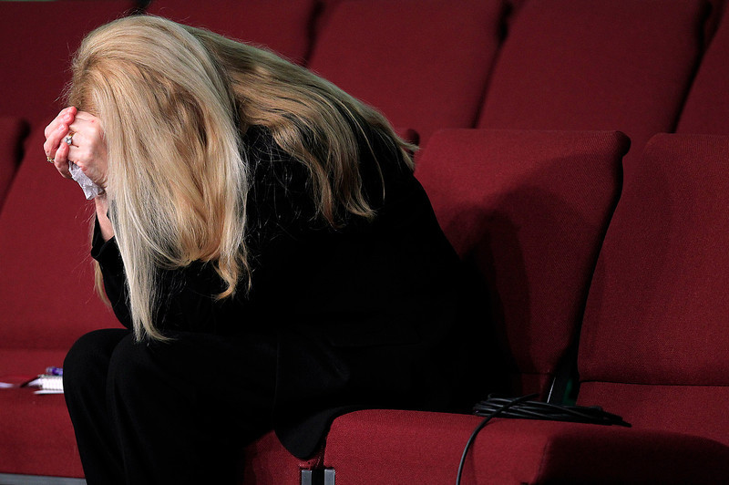 . Gayle Inge, mother of Mindy McCready, prays with the congregation at the end of the funeral service for her daughter at the Crossroads Baptist Church in Fort Myers, Fla., on Tuesday, Feb. 26, 2013.  McCready committed suicide Feb. 17 at her home in Arkansas, days after leaving a court-ordered substance abuse program. (AP Photo/Naples Daily News, Corey Perrine)