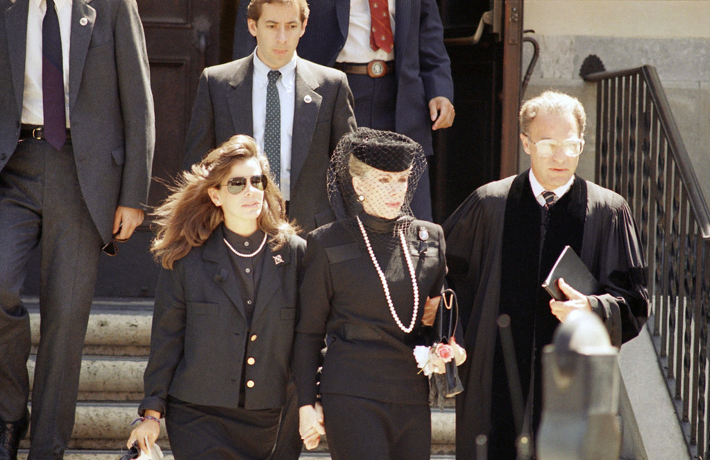 . Entertainer Joan Rivers, right, and her 19-year-old daughter, Melissa, leave hand in hand the memorial service for Edgar Rosenberg, Joan\'s husband and Melissa\'s father, in Los Angeles on Sunday, August 16, 1987. Over 300 mourners gathered at the Wilshire Boulevard Temple to pray and listen to remembrances of Rosenberg who committee suicide last week. (AP photo/Lennox McLendon)