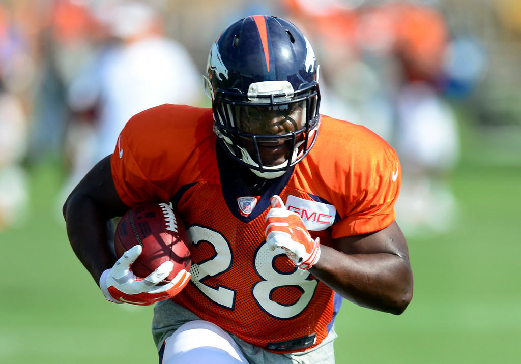 . Montee Ball (28) runs through drills on Saturday. The Denver Broncos football team hold their workouts for the team during mini-camp at Dove Valley in Centennial on Saturday, July 26, 2014. (Photo by Kathryn Scott Osler/The Denver Post)