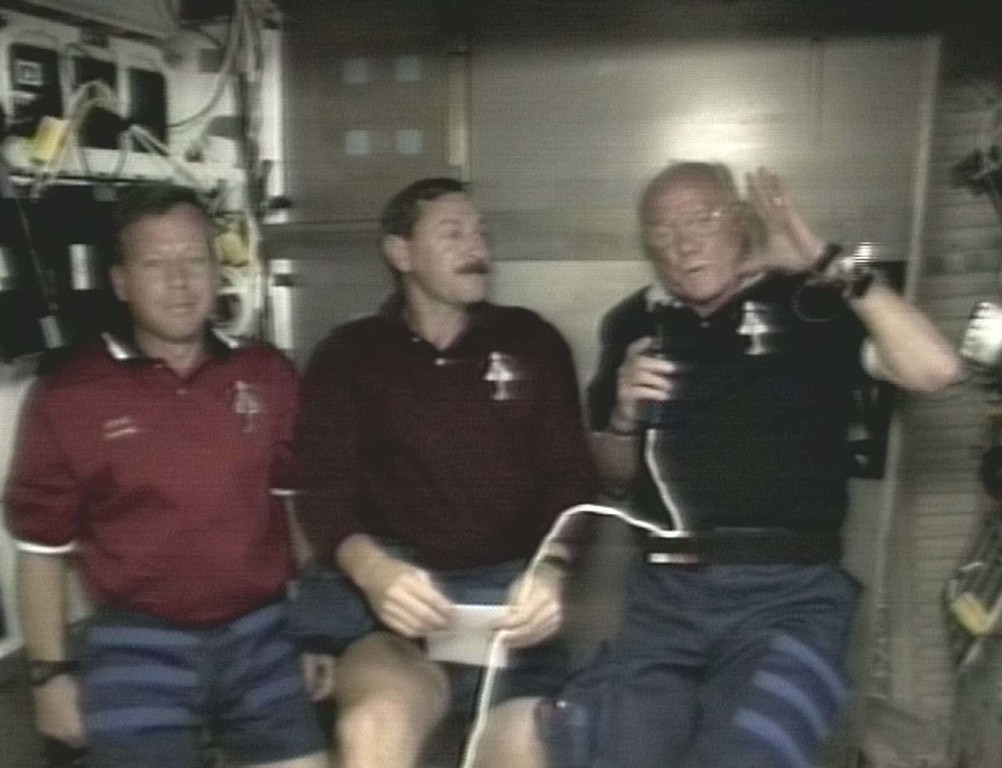 . Astronaut John Glenn, right, displays his swollen face during a mission status briefing with flight pilot Steve Lindsey, left, and commander Curt Brown Friday, Oct. 30, 1998, in this image from NASA television.  All the astronauts display some facial puffiness in the first day or two in zero-gravity conditions.  (AP Photo/NASA TV)