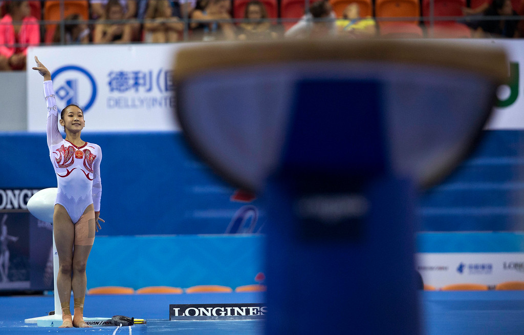 . China\'s Bai Yawen gestures as she prepares to perform on the vault during the women\'s qualifying round of the Artistic Gymnastics World Championships at the Guangxi Gymnasium in Nanning, capital of southwest China\'s Guangxi Zhuang Autonomous Region Monday, Oct. 6, 2014. (AP Photo/Andy Wong)