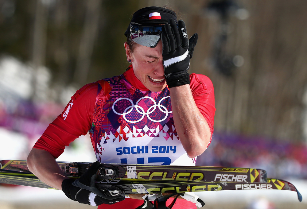 . Justyna Kowalczyk of Poland reacts after crossing the finish line during the Ladies\' 10km Classic Cross-Country during day six of the Sochi 2014 Winter Olympics at Laura Cross-country Ski & Biathlon Center on February 13, 2014 in Sochi, Russia.  (Photo by Ryan Pierse/Getty Images)