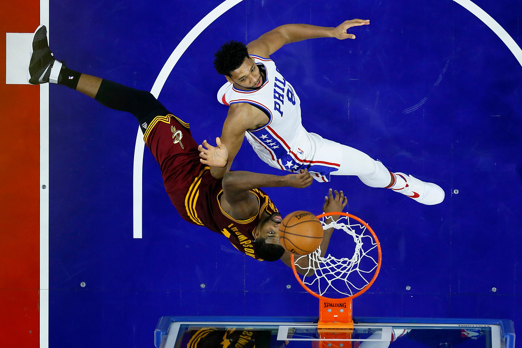. Philadelphia 76ers\' Jahlil Okafor, top, watches his shot against Cleveland Cavaliers\' Tristan Thompson during an NBA basketball game, Sunday, Nov. 27, 2016, in Philadelphia. (AP Photo/Matt Slocum)