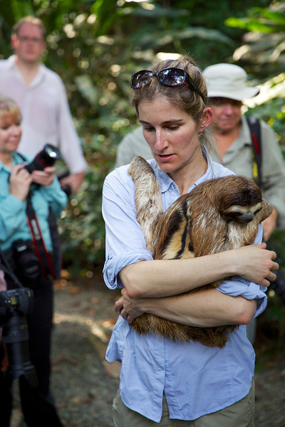 "<a href=""http://www.suzieszterhas.com/"">Suzi Eszterhas</a>, the leader of our photography tour, with Sid, a three-fingered sloth."