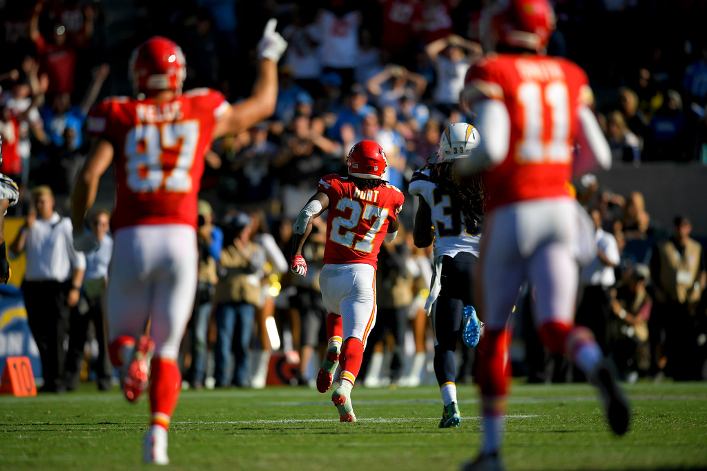 . Kansas City Chiefs running back Kareem Hunt (27) scores against the Los Angeles Chargers during the second half of an NFL football game against the Los Angeles Chargers Sunday, Sept. 24, 2017, in Carson, Calif. (AP Photo/Mark J. Terrill)