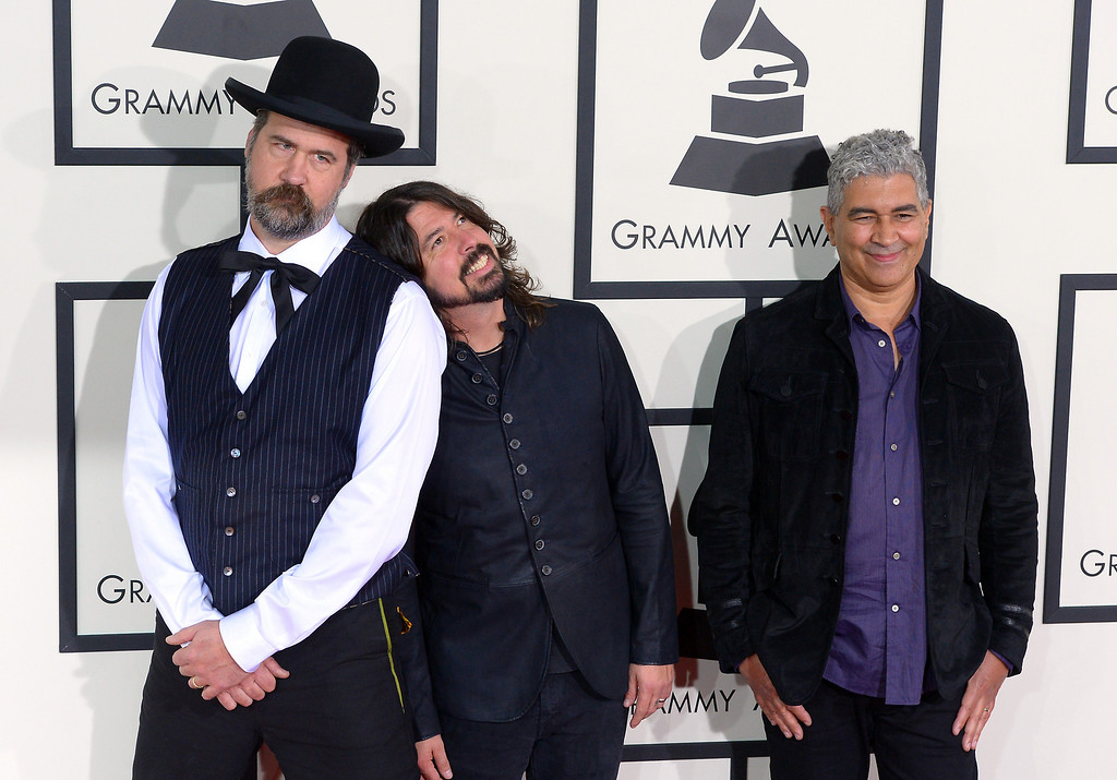 . Krist Novoselic, Dave Grohl and Pat Smear arrive at the 56th Annual GRAMMY Awards at Staples Center in Los Angeles, California on Sunday January 26, 2014 (Photo by David Crane / Los Angeles Daily News)