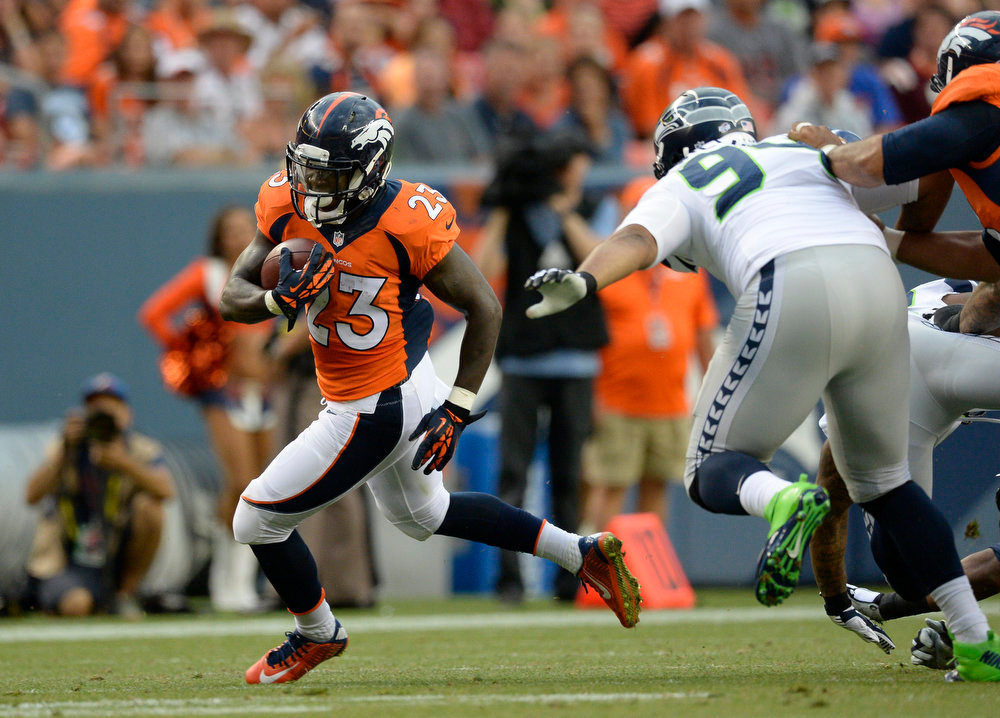 . Running back Ronnie Hillman (23) of the Denver Broncos picks up a gain again the Seattle Seahawks August 7, 2014 at Sports Authority Field at Mile High Stadium.  (Photo by John Leyba/The Denver Post)