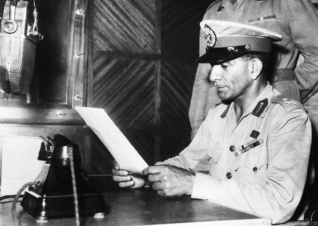 . General Mohamed Neguib Bey,who engineered the recent coup d\'etat, broadcasts to the people of Egypt, in Cairo July 24, 1952. After the bloodless coup Aly Maher Pasha took office as Premier and on July 26 issued an abdication ultimatum to King Farouk. The king abdicated in favour of his seven-month-old son, Prince Ahmed Fuad, and left the country for Italy on his royal yacht. (AP Photo)