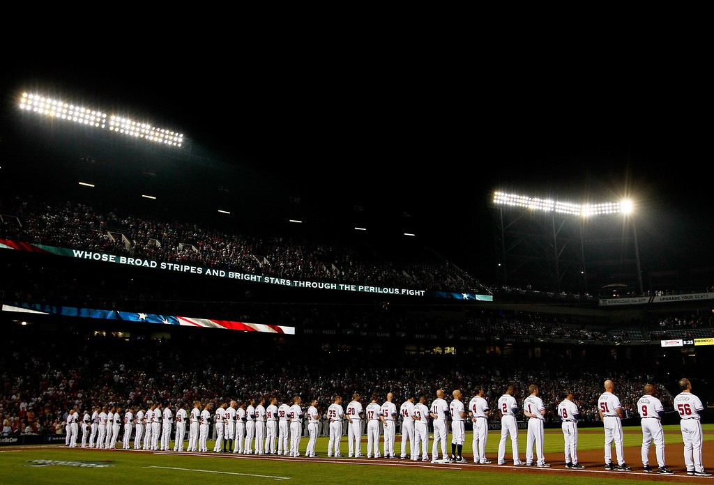 . ATLANTA, GA - OCTOBER 03: The Atlanta Braves line up during the national anthem before Game One of the National League Division Series against the Los Angeles Dodgers at Turner Field on October 3, 2013 in Atlanta, Georgia.  (Photo by Kevin C. Cox/Getty Images)