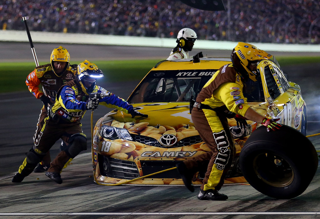 . Kyle Busch, driver of the #18 M&M\'s Toyota, pits during the NASCAR Sprint Cup Series Daytona 500 at Daytona International Speedway on February 23, 2014 in Daytona Beach, Florida.  (Photo by Tom Pennington/Getty Images)