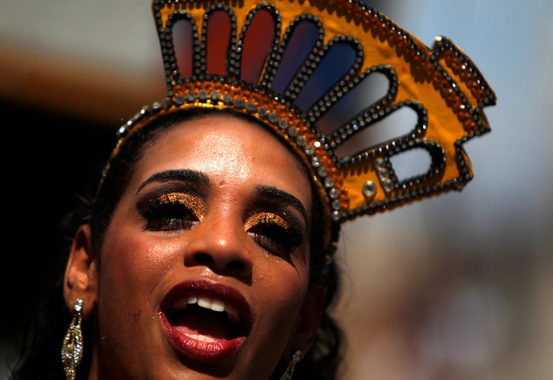 . A reveller dances during the annual block party known as \'Carmelitas\', one of the many carnival parties to take place in the neighbourhoods of Rio de Janeiro, February 8, 2013. REUTERS/Pilar Olivares