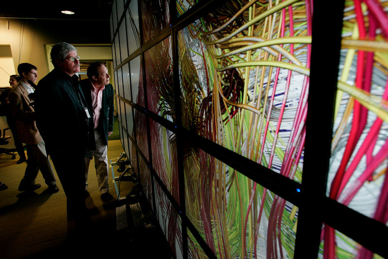 """Next-Generation Visualization and Networking Facilities, Calit2 (the """"FiRe Lab""""), UCSD: Doug Smith (foreground) and Bill Haseltine"""