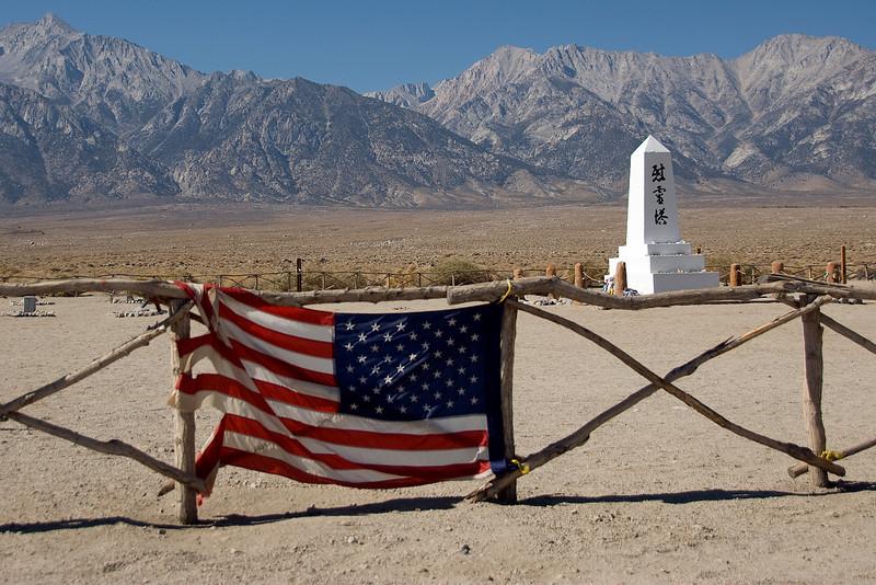 American flag near monument at Manzanar cemetery in California